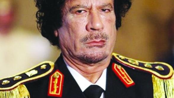 """""""Vulturii business"""" sar pe Libia, dupa moartea lui Gaddafi"""