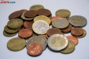 Curs valutar: Euro si dolarul termina saptamana in crestere