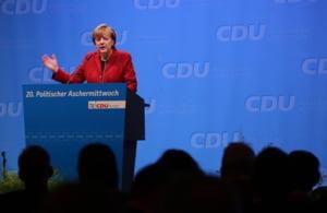 Angela Merkel promite Turciei ca o va ajuta sa intre mai repede in UE