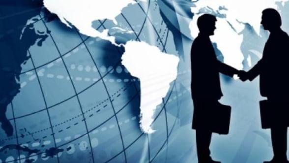 Anul investitiilor: Piata globala de fuziuni si achizitii, aproape de recordurile istorice
