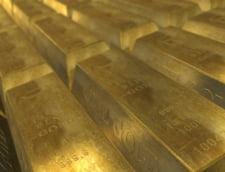 Aurul a atins miercuri un nou maxim istoric. Euro si francul elvetian au crescut, dolarul a scazut, in raport cu moneda nationala