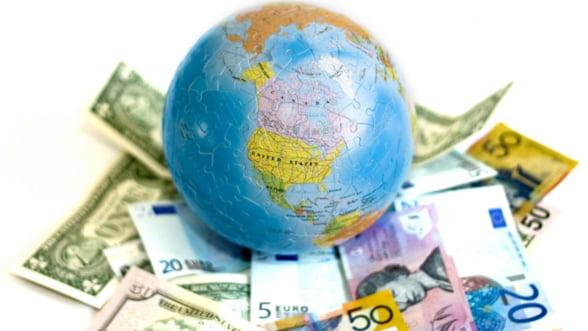 Avertisment OCDE: Politicile monetare divergente si nationalismul economic pun in pericol redresarea economiei globale