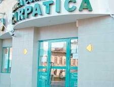 Banca Carpatica si-a adancit pierderile de aproape 5 ori in T1