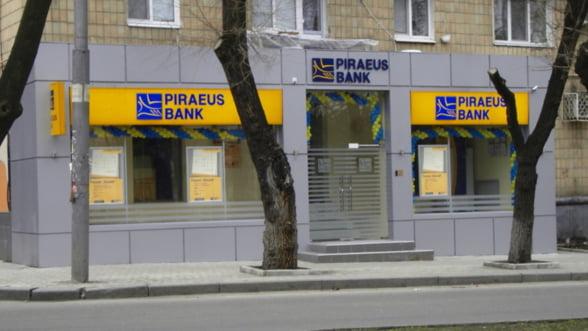 Bancile elene strang randurile in sud-estul Europei. Se anunta fuziuni de criza