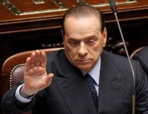 Berlusconi:Filialele din Romania ale bancilor italiene nu vor fi afectate de criza financiara