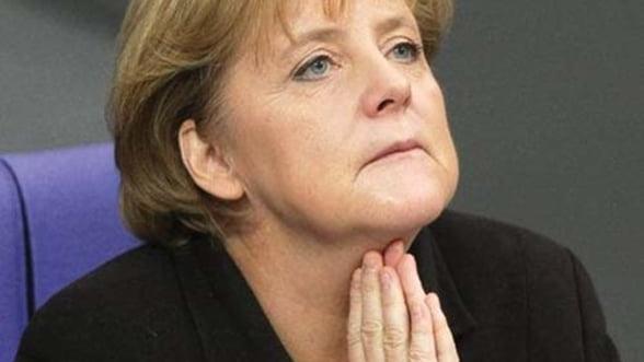 Cancelarul german a aparat euro in mesajul de Anul Nou