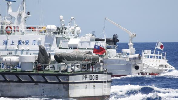 China rabufneste: SUA ne violeaza apele si spatiul aerian!