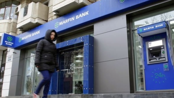 Clientii Bank of Cyprus isi pot retrage banii de la Marfin Bank Romania de luni