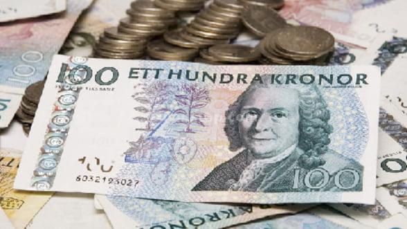 """Coroana suedeza este """"noul franc elvetian"""""""