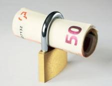 Datoriile bancilor din Romania catre grupurile-mama atarna greu pe umerii clientilor
