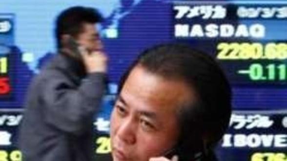 Euro scade, actiunile asiatice cresc