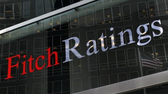 Fitch a pus sub supraveghere negativa ratingurile privind datoriile Japoniei