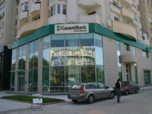 GarantiBank a lansat un serviciu de plata in numerar a facturilor Romtelecom la ghiseele bancii