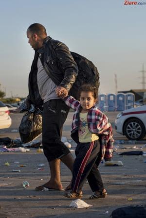 """Germania trece de la vorbe la fapte: """"Adopta"""" sute de imigranti blocati in Italia"""