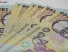 Guvernul a stors o suma record de la companiile de stat, ca sa acopere deficitul bugetar