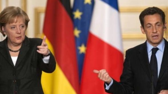 Intalnire Merkel - Sarkozy. Viata euro, salvata prin suprataxarea bancilor?