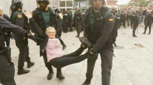 Madridul isi cere scuze pentru actiunile violente ale politiei si vrea anticipate in Catalonia