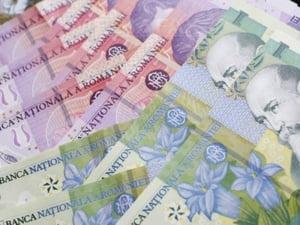 Mai putini bani pentru bugetarii care si-au castigat salariul in instanta