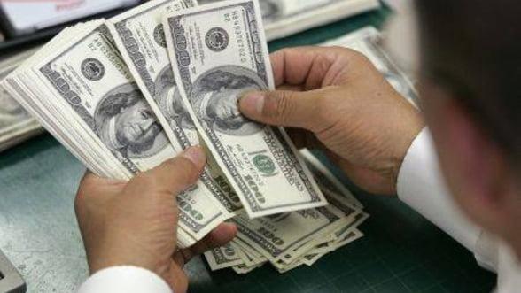 Mari banci americane ar putea taxa deponentii, in loc sa le plateasca dobanda