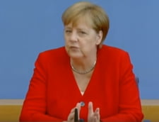 Merkel anunta ca e capabila sa-si exercite functia, dupa crizele de tremurat