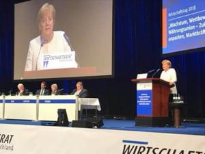 Merkel nu este de acord cu termenii radicali folositi de Macron la adresa NATO