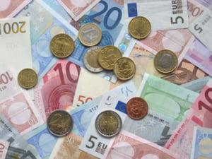 Patronatul european saluta scaderea monedei unice