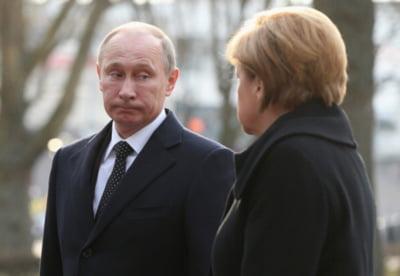 Putin si Merkel: pozitii diferite, viziune comuna