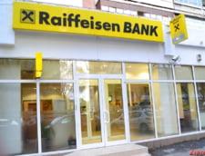 Raiffeisen Bank face o noua oferta clientilor cu credite in franci elvetieni - reducerea datoriei e de 25%