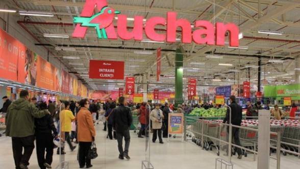 Real si-a redus pierderile, iar viitorul proprietar, Auchan, a trecut pe profit