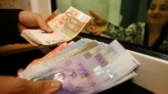 Restantierii la creditele in franci elvetieni ar putea scapa temporar de executarea silita