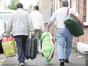 Reuters: Printre valuri de critici, romanii isi croiesc vieti noi in Marea Britanie