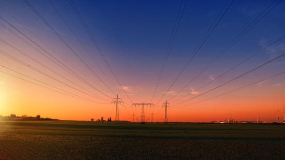 Romania importa peste 1.700 de MW de electricitate marti dimineata, aproape de capacitatea maxima