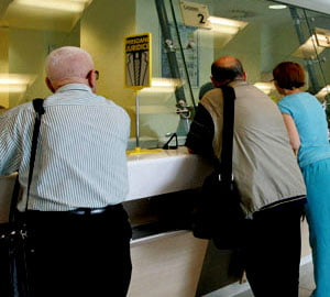 Romanii vor putea avea acces liber pe piata muncii din Elvetia din 2016