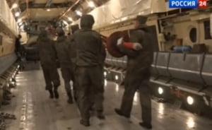 Rusii au inceput retragerea din Siria: Militarii incarca avioanele la TV (Video)