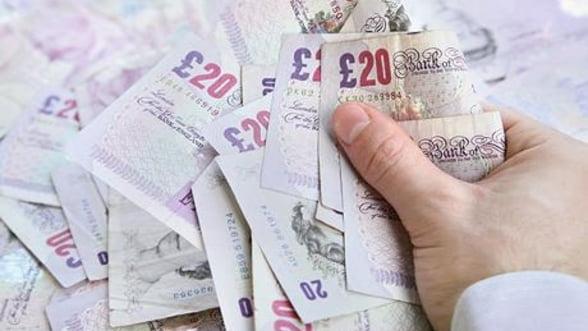 Salariul minim din Marea Britanie, o mica avere pentru romani si bulgari