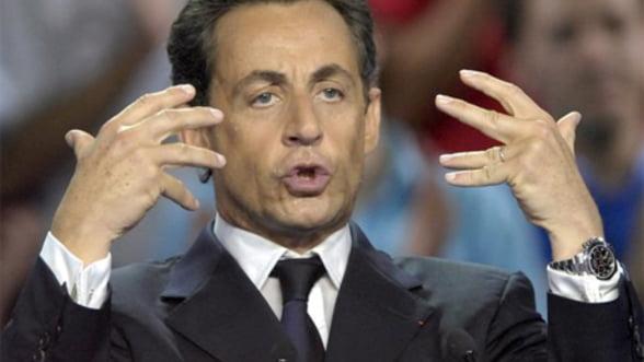 Sarkozy: Criza poate fi depasita cu vointa si curaj