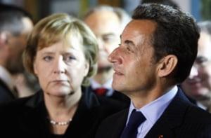 Sarkozy si Merkel promit un pachet impotriva crizei, fara a da detalii