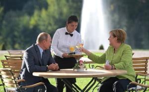 Sincronizarea ceasurilor - varianta Kremlinului dupa intalnirea istorica Merkel-Putin