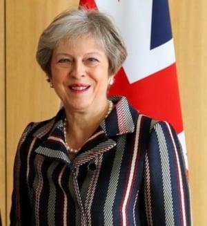 Theresa May, zguduita de un val de demisii, avertizeaza ca exista riscul ca Brexitul sa nu aiba loc