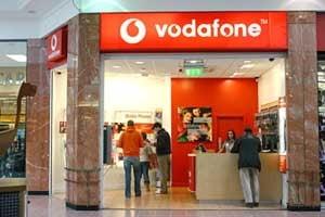 UniCredit Tiriac Bank, Romcard si Vodafone lanseaza un serviciu de plata a facturilor prin telefon