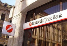 UniCredit Tiriac Bank, profit net la jumatate in T1