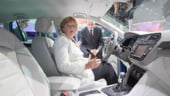 Cauta protectie? Seful Volkswagen se duce in China insotit de Angela Merkel