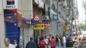 Schimbari la varf, mii de concedieri si scandaluri - bancile din Romania in 2012