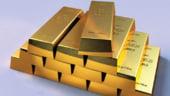 Pretul aurului scade cu 1%, tras in jos de euro