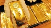 Aurul se devalorizeaza accelerat, din cauza dolarului tot mai puternic