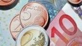 Cursul valutar s-a depreciat pana la 4,1097 lei/euro