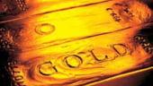 Aurul se scumpeste pe fondul deprecierii dolarului si stabilizarii pretului la petrol