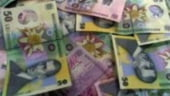 Leul pierde aproape 2 bani pana la 3,67 lei/euro