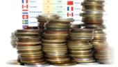 Cursul valutar: Moneda nationala se depreciaza pana la 4,0997 lei/euro