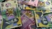 Leul a oscilat in jurul nivelului de 3,7250 lei/euro in prima parte a zilei
